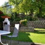 Von der Küche in den eigenen Sitzgarten - Ferienwohnung Kaminfeuer
